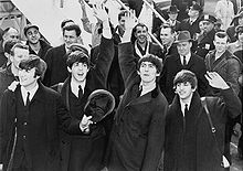 "In 1964 just after stepping onto the tarmac from their plane arriving in New York City, the famed British rock band ""The Beatles"" were mobbed by nearly three thousand screaming fans.."